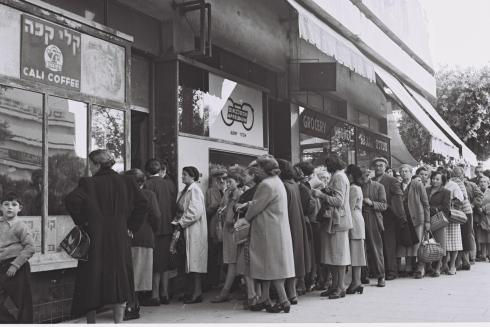 CITIZENS OF TEL AVIV STANDING IN LINE TO PURCHASE FOOD RATIONS AGAINST SPECIAL COUPONS IN TEL AVIV.